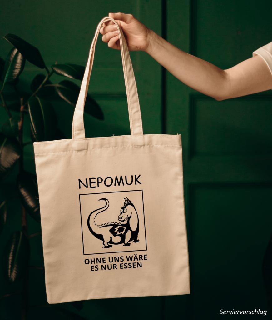 """Tasche in Naturfarbe mit dem Nepomuk-Drachen, Nepomuk Schriftzug und dem Text """"Ohne uns wäre es nur Essen"""""""